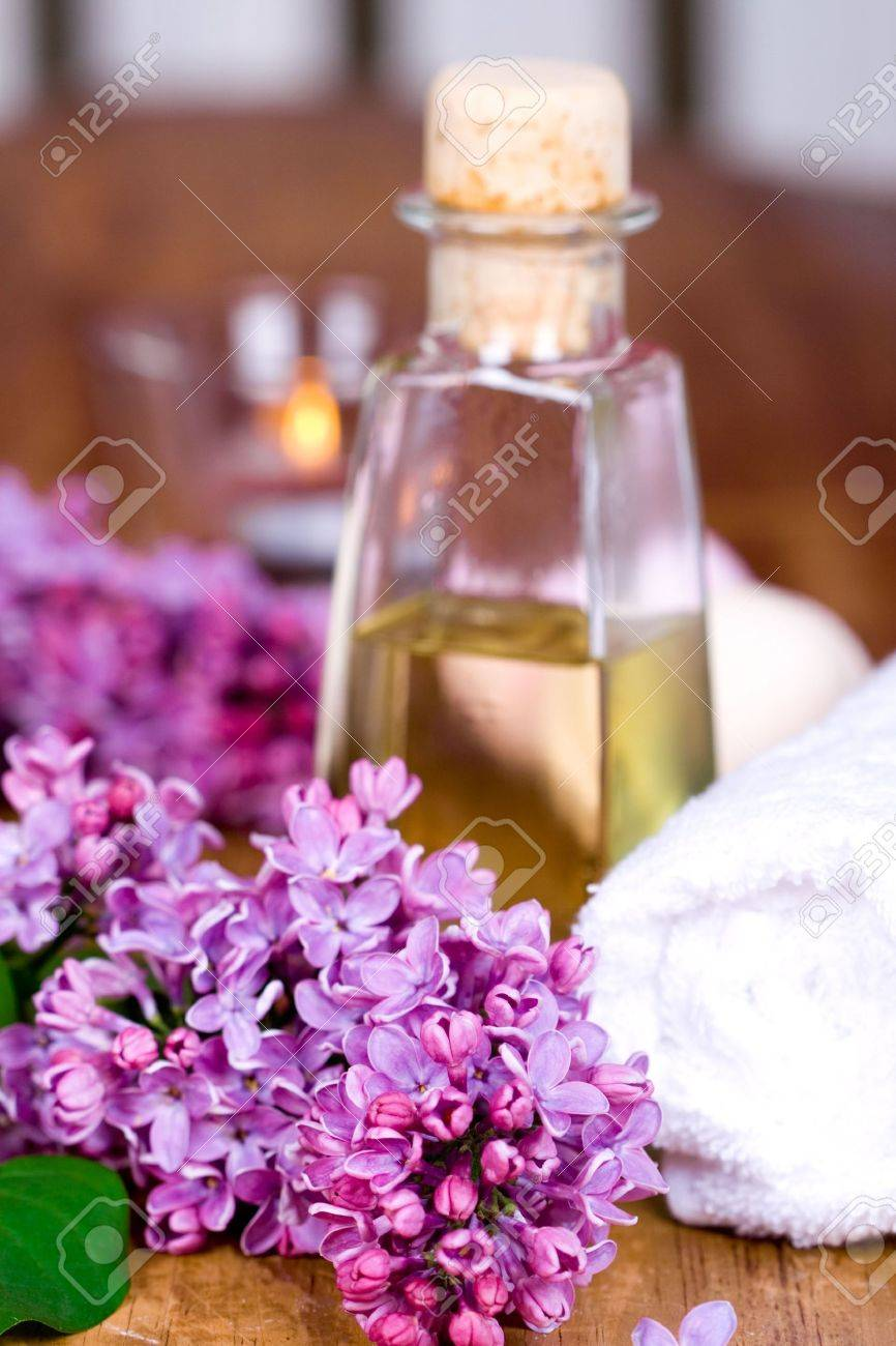 bath and spa items (towel, oil, lilac, candle) on wooden background Stock Photo - 6971865