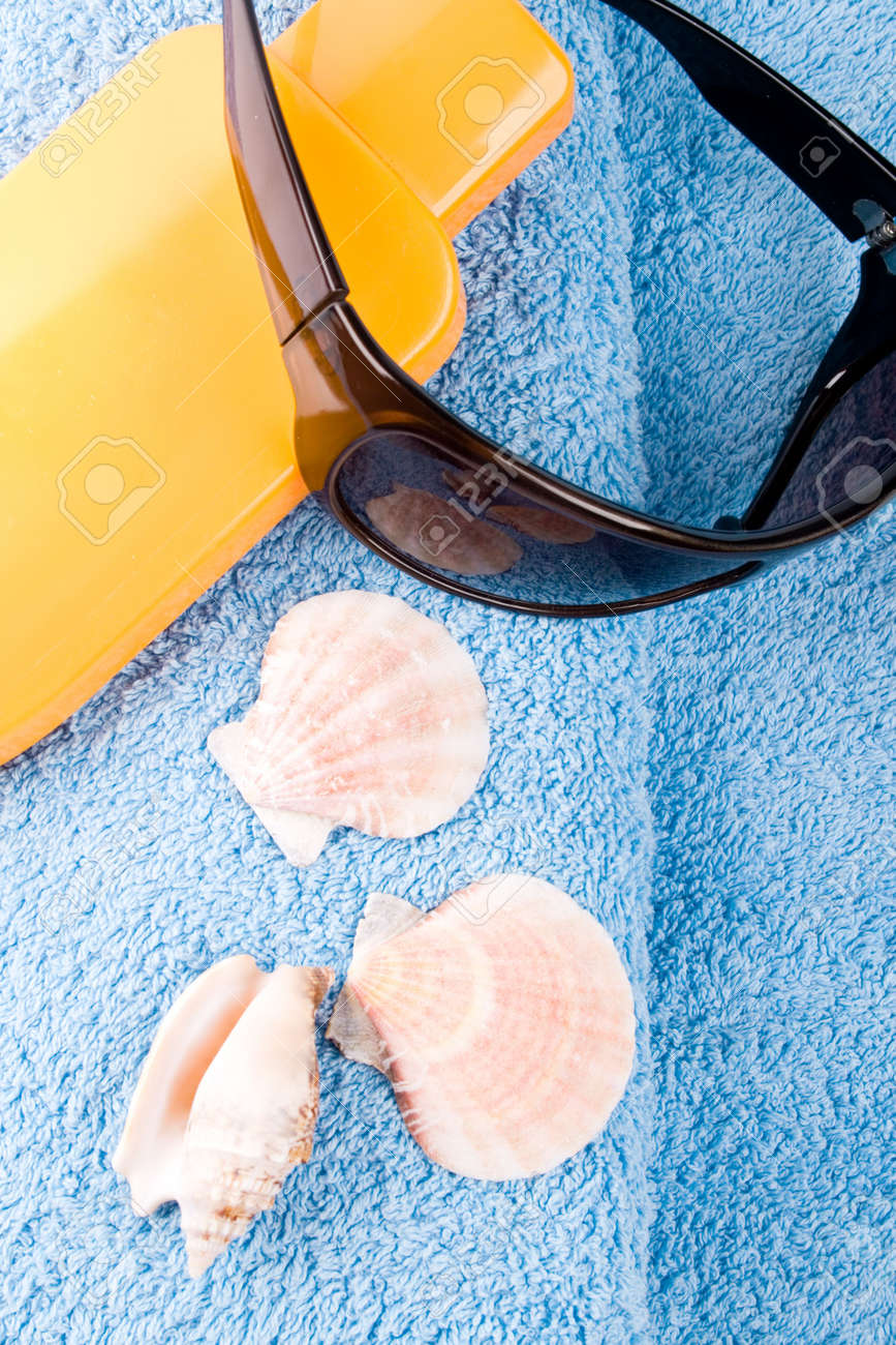 towel, sunglasses and lotion closeup Stock Photo - 6971952