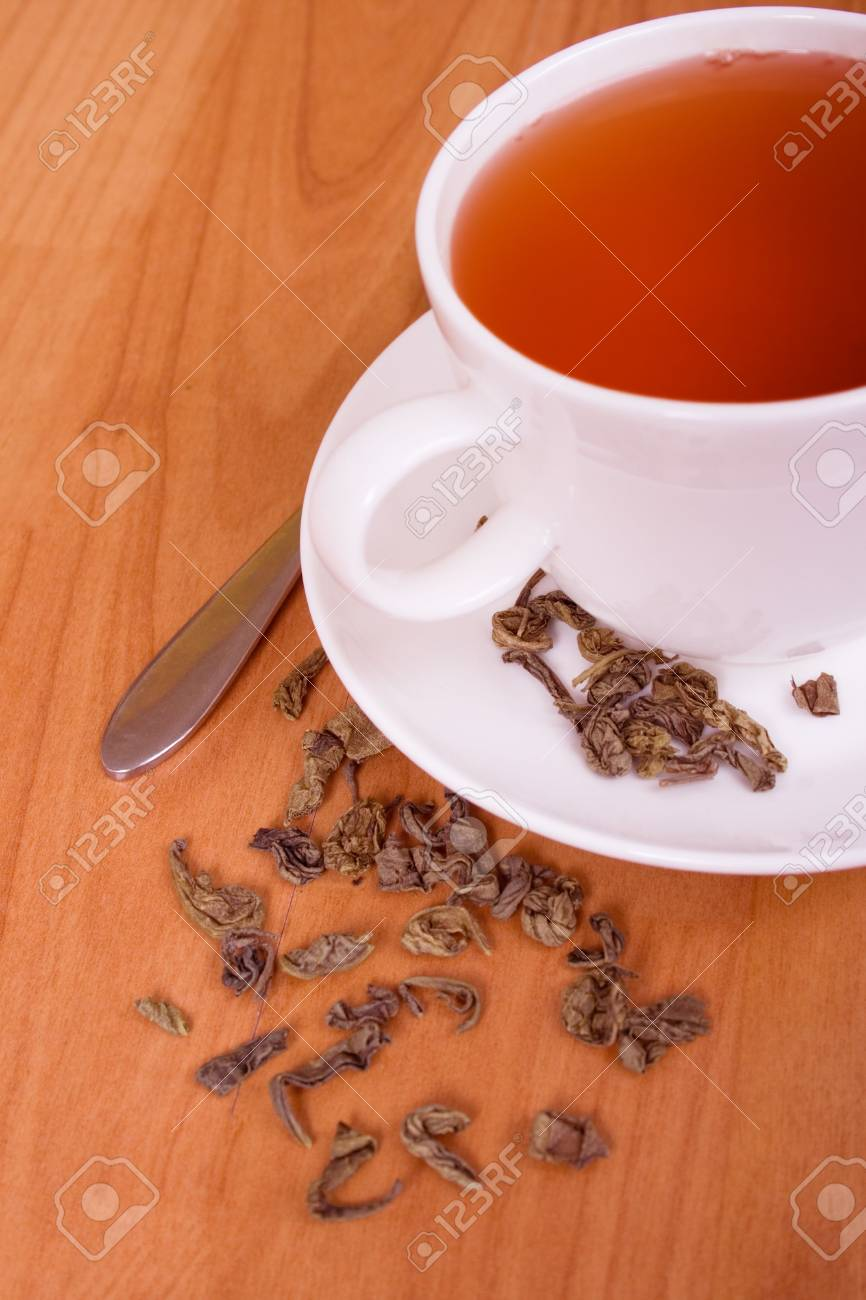 cup of green tea on a wooden table Stock Photo - 6972002