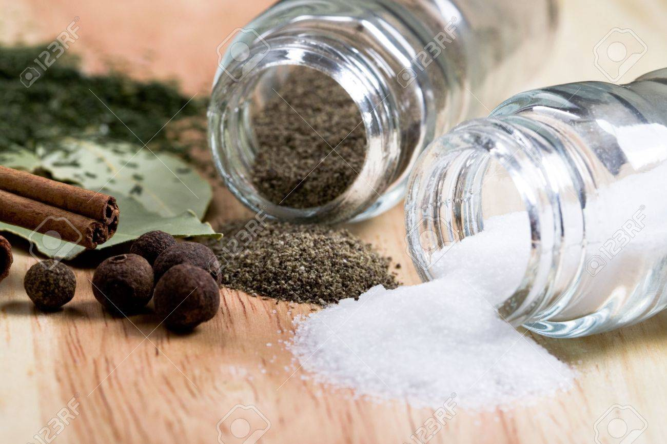 spices: pepper, salt, bay leaves, cinnamon and herbs closeup on wooden background Stock Photo - 7089399