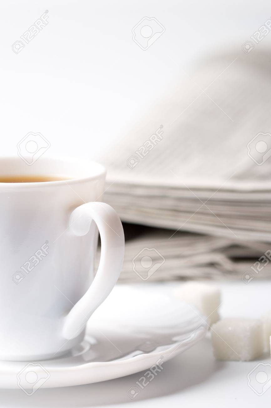 cup of coffee, sugar and stack of newspapers closeup Stock Photo - 7089387