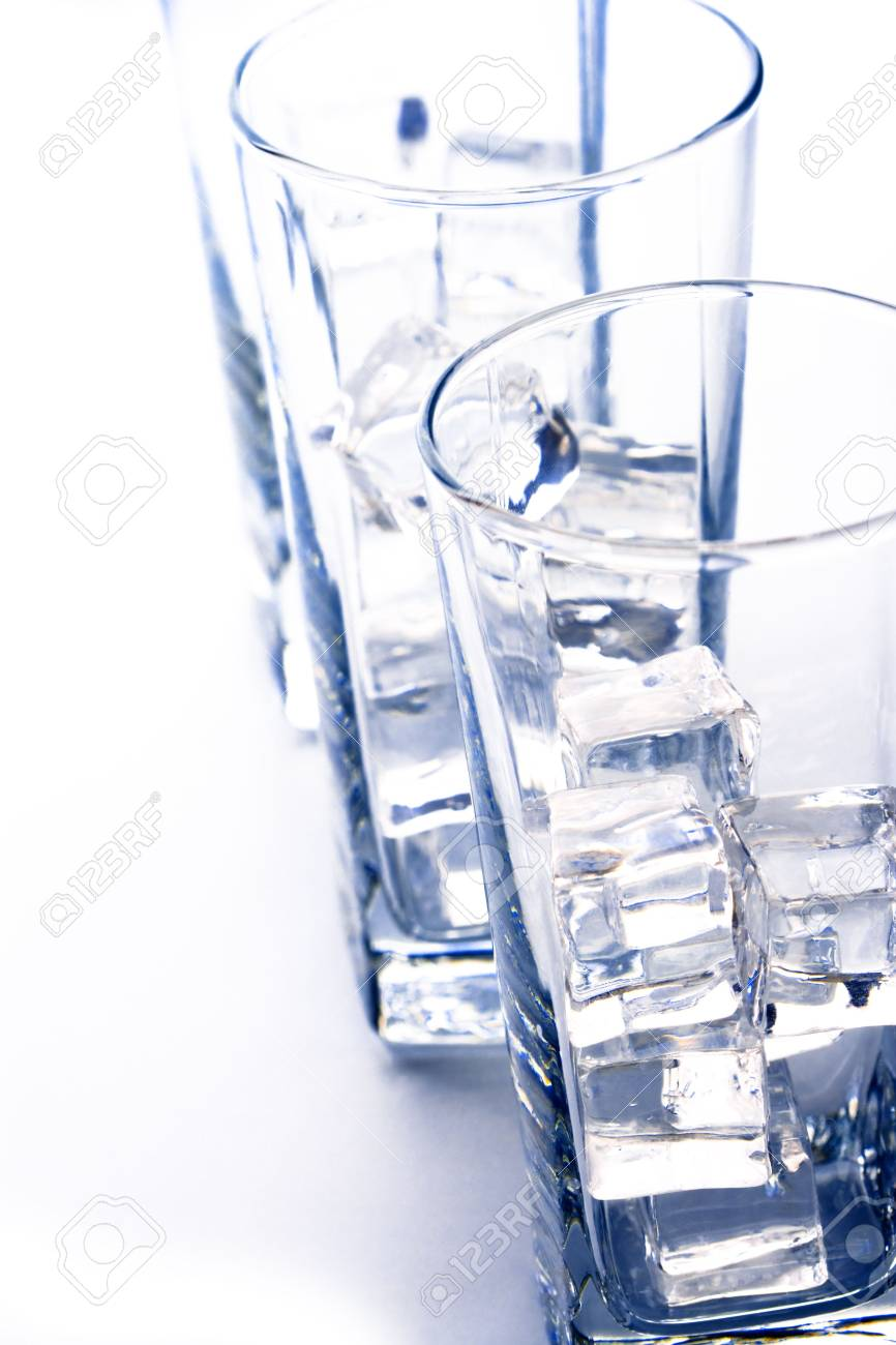three glasses with ice cubes closeup on white background Stock Photo - 7208021