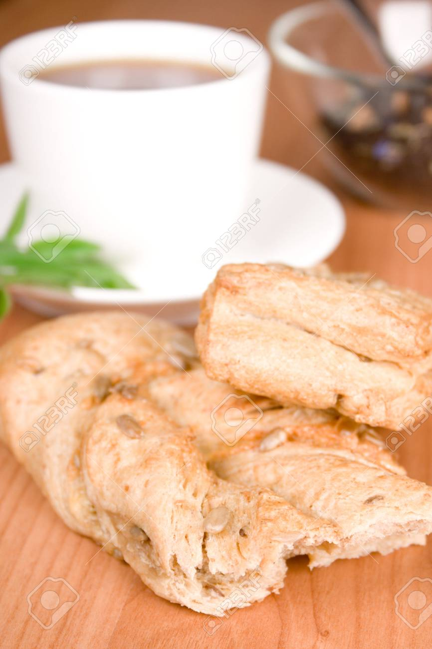 cup of black tea with herbs and bread closeup Stock Photo - 7276897