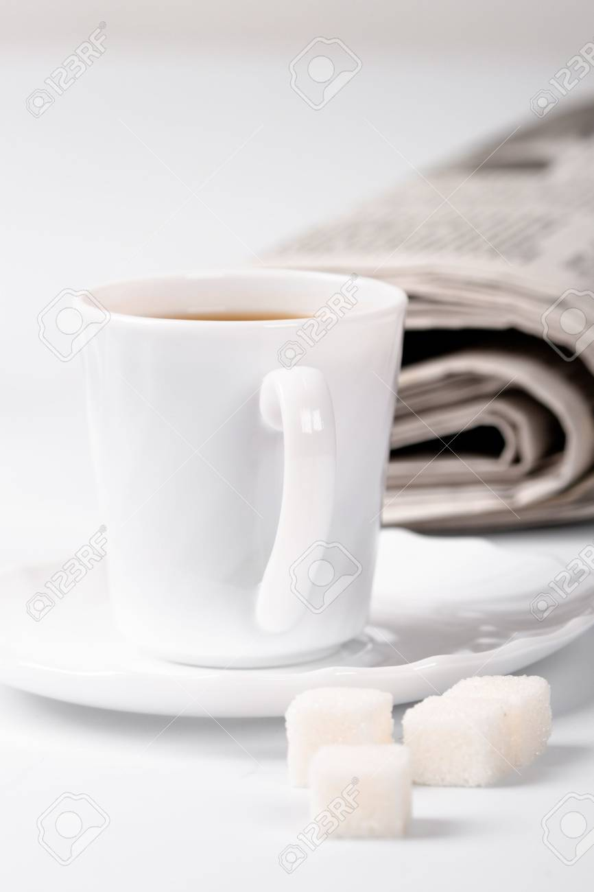 cup of coffee, sugar and stack of newspapers closeup Stock Photo - 7716734