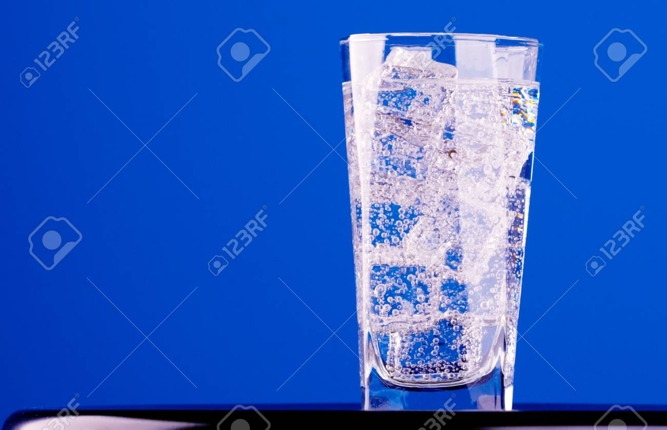 glass with iced water on blue background Stock Photo - 7783961