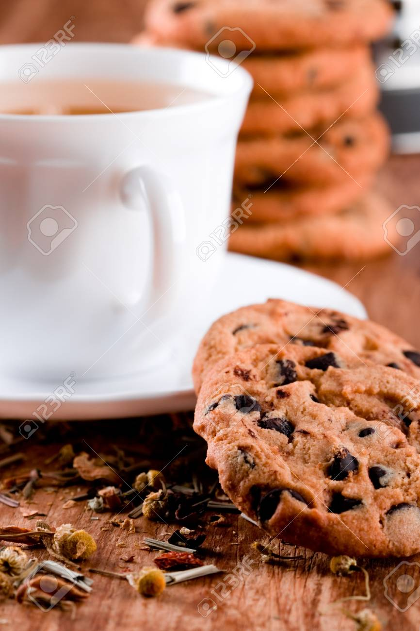 cup of herbal tea and some fresh cookies closeup on wooden table Stock Photo - 8646111
