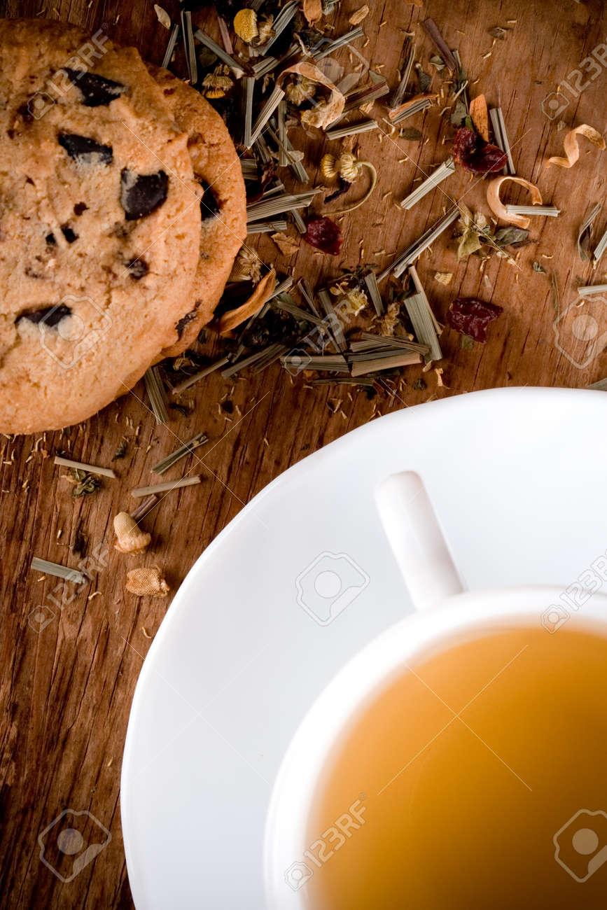cup of herbal tea and some fresh cookies closeup on wooden table Stock Photo - 8646131