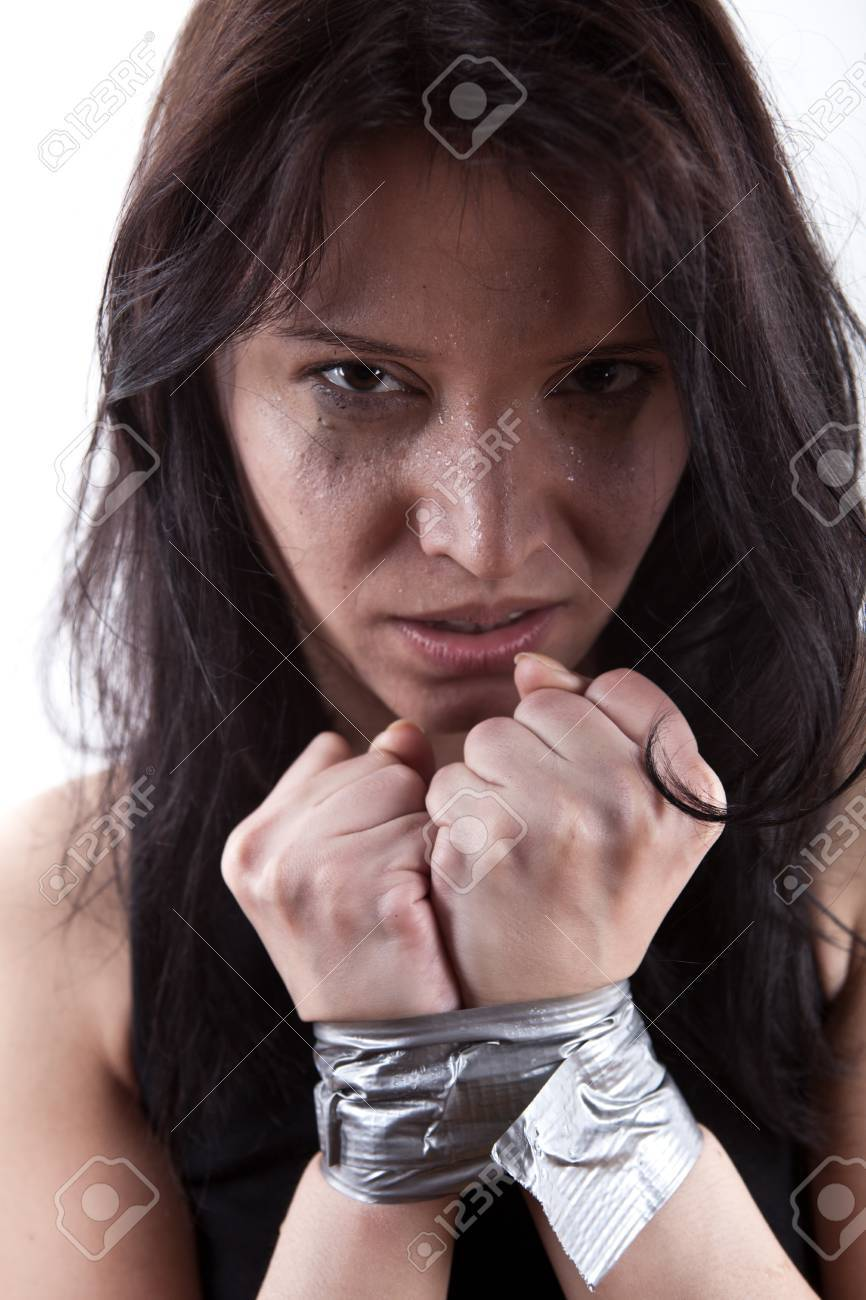 kidnapped young woman, hostage closeup on white background Stock Photo - 8889972