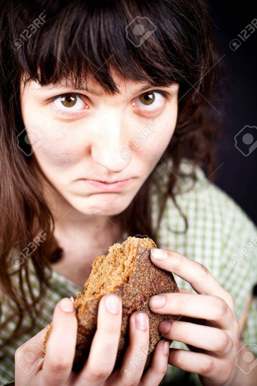 portrait of a poor beggar woman with a piece of bread in her hands Stock Photo - 9389471