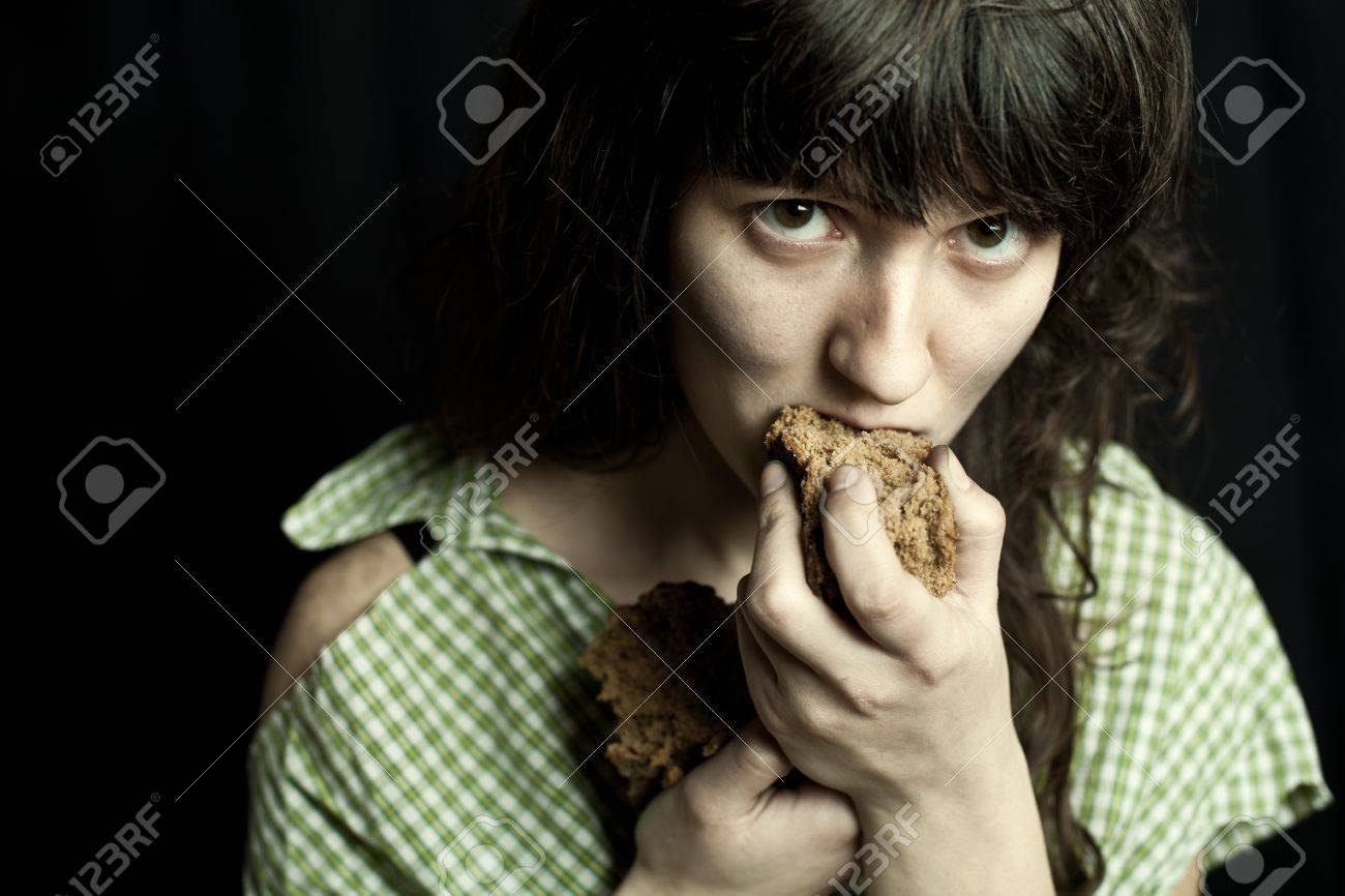 portrait of a poor beggar woman eating bread Stock Photo - 20547442