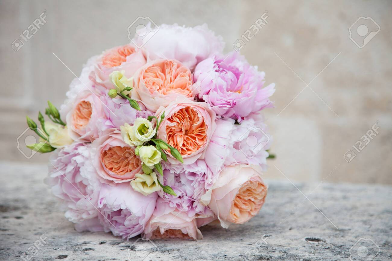 Wedding Bouquet From Orange Roses Pink Peonies And Cream Flowers Stock Photo Picture And Royalty Free Image Image 119291398