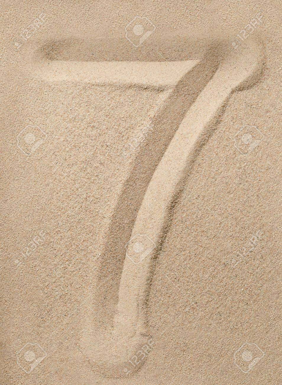 Number Seven Writing On The Sand Stock Photo, Picture And Royalty Free Image. Image 16851060.