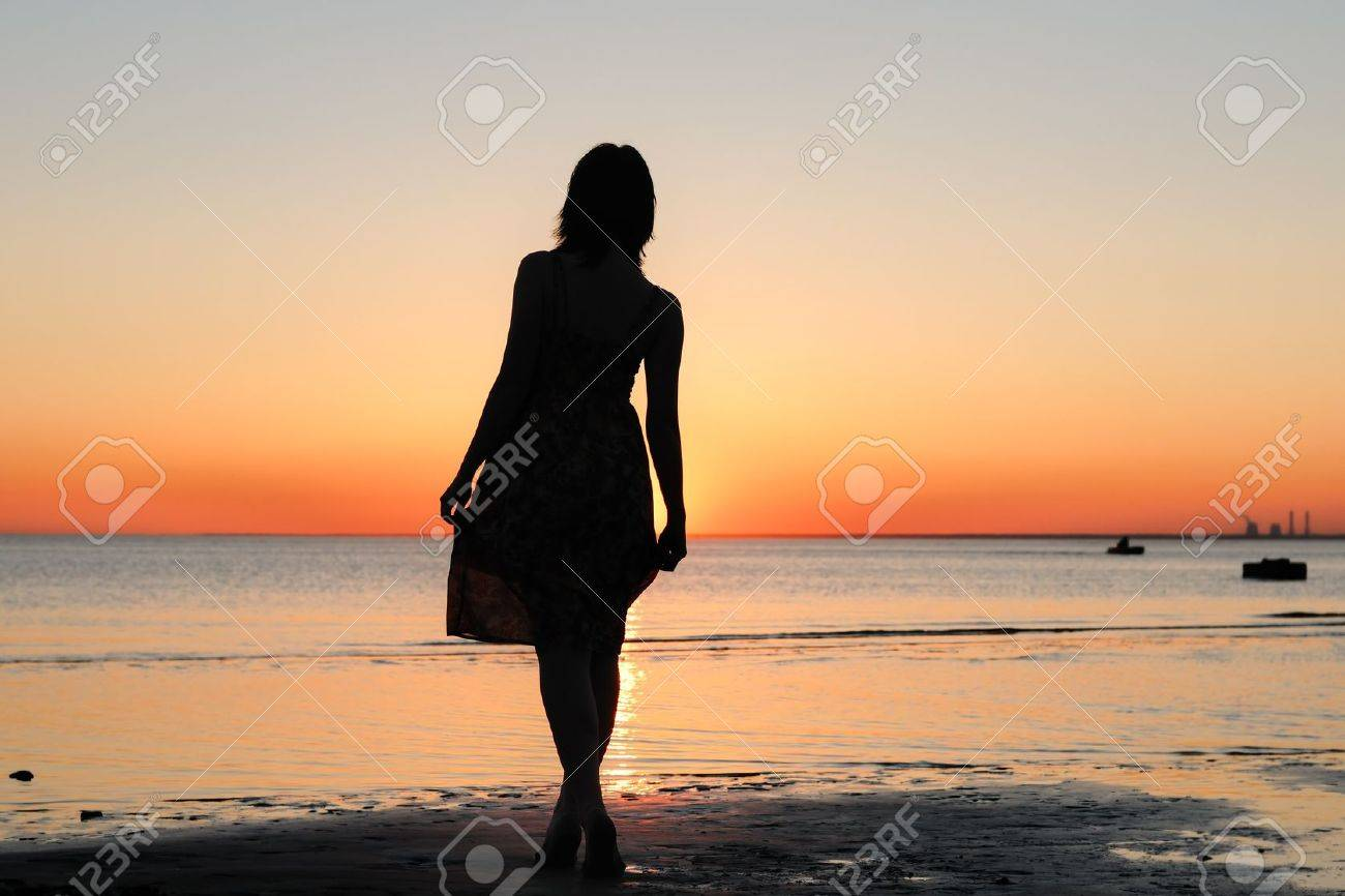 Portrait of young woman as silhouette by the sea Stock Photo - 10178978