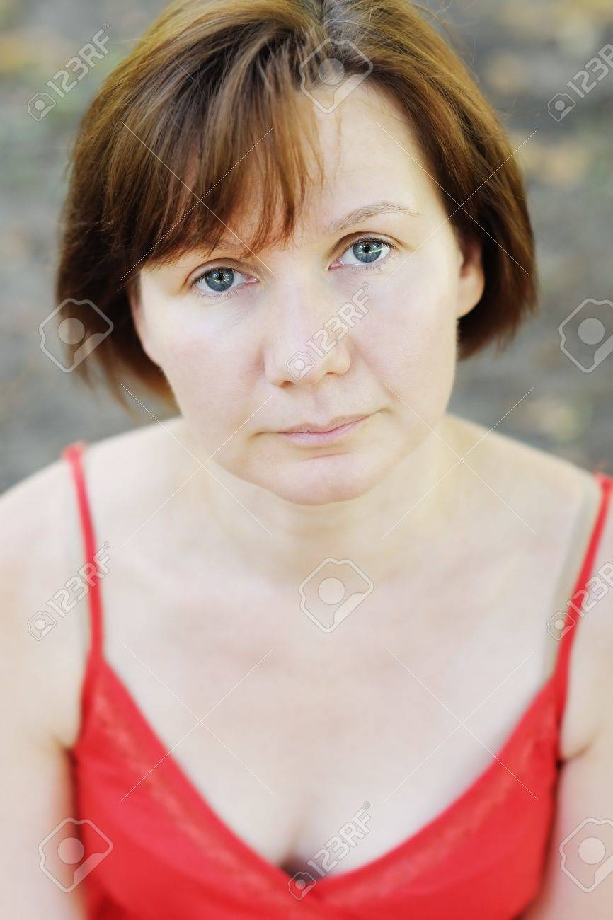 Pensive middle age woman, outdoors portrait Stock Photo - 12629592