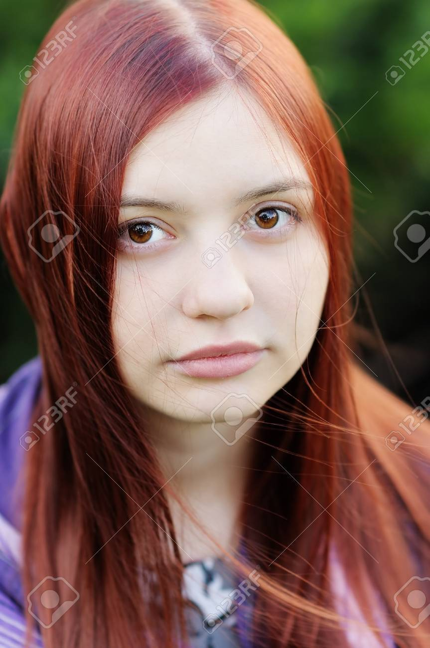 Outdoors portrait of young beautiful girl with big brown eyes Stock Photo - 13718515