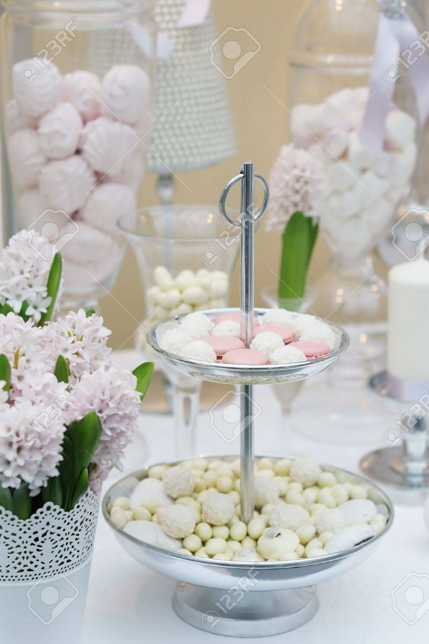 Delicious wedding sweets  yellow and pink table set Stock Photo - 18802039