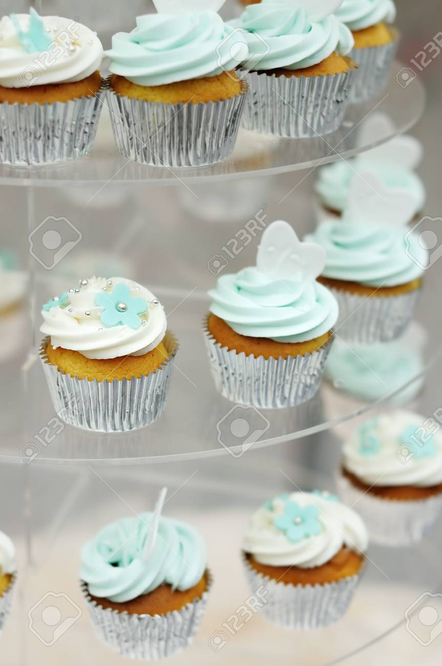 Delicious colorful  white and blue  wedding cupcakes Stock Photo - 18937347