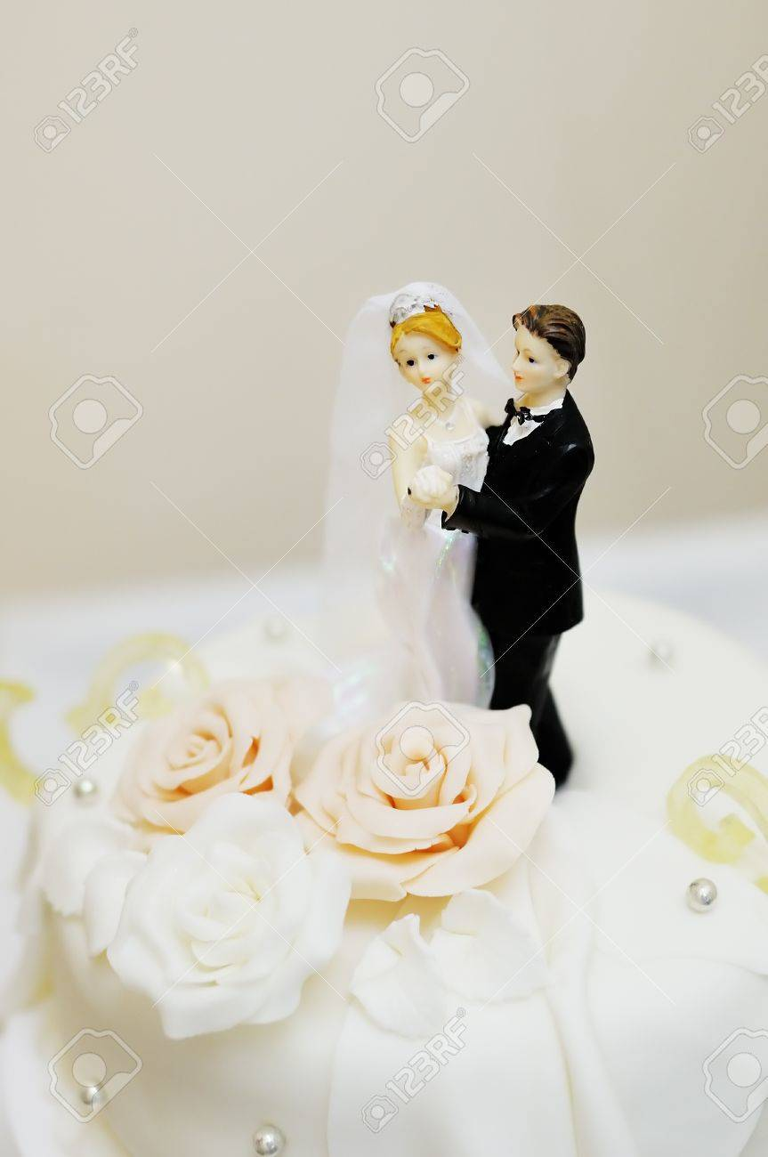 Figurines On Top Of Wedding Cake Stock Photo, Picture And Royalty ...