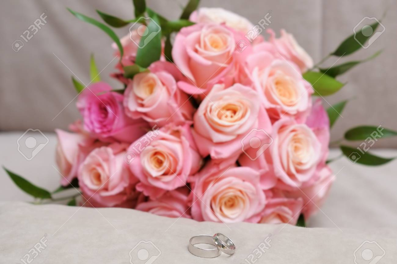Two Wedding Rings Made Of White Gold And Pink Wedding Bouquet Stock ...