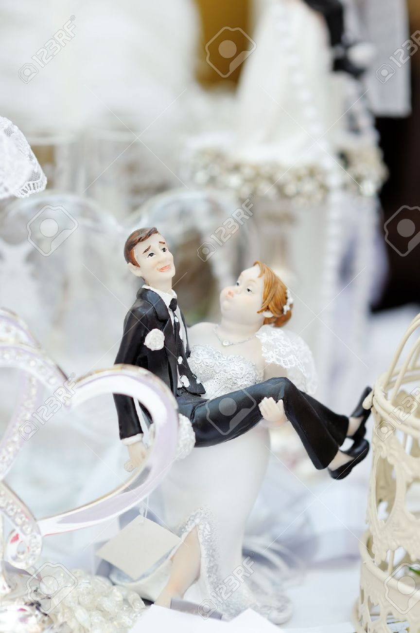 Funny Figurines Bride And Groom On Top Of Wedding Cake Stock Photo ...