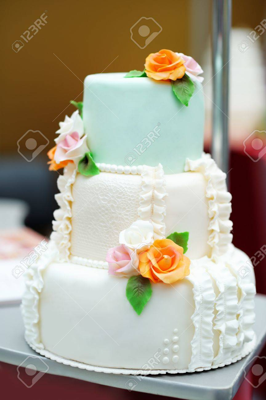 Delicious White And Green Wedding Cake Decorated Orange Cream ...