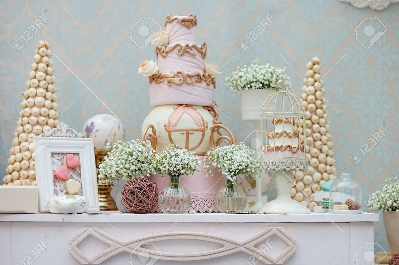 Elegant sweet table with big cake and macaroon on dinner or event party - 28378086