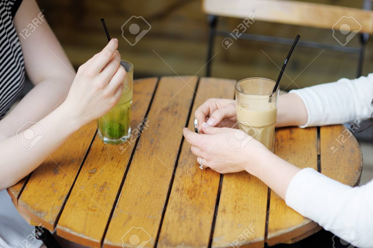 Hands with drinks of two girls - 29263547