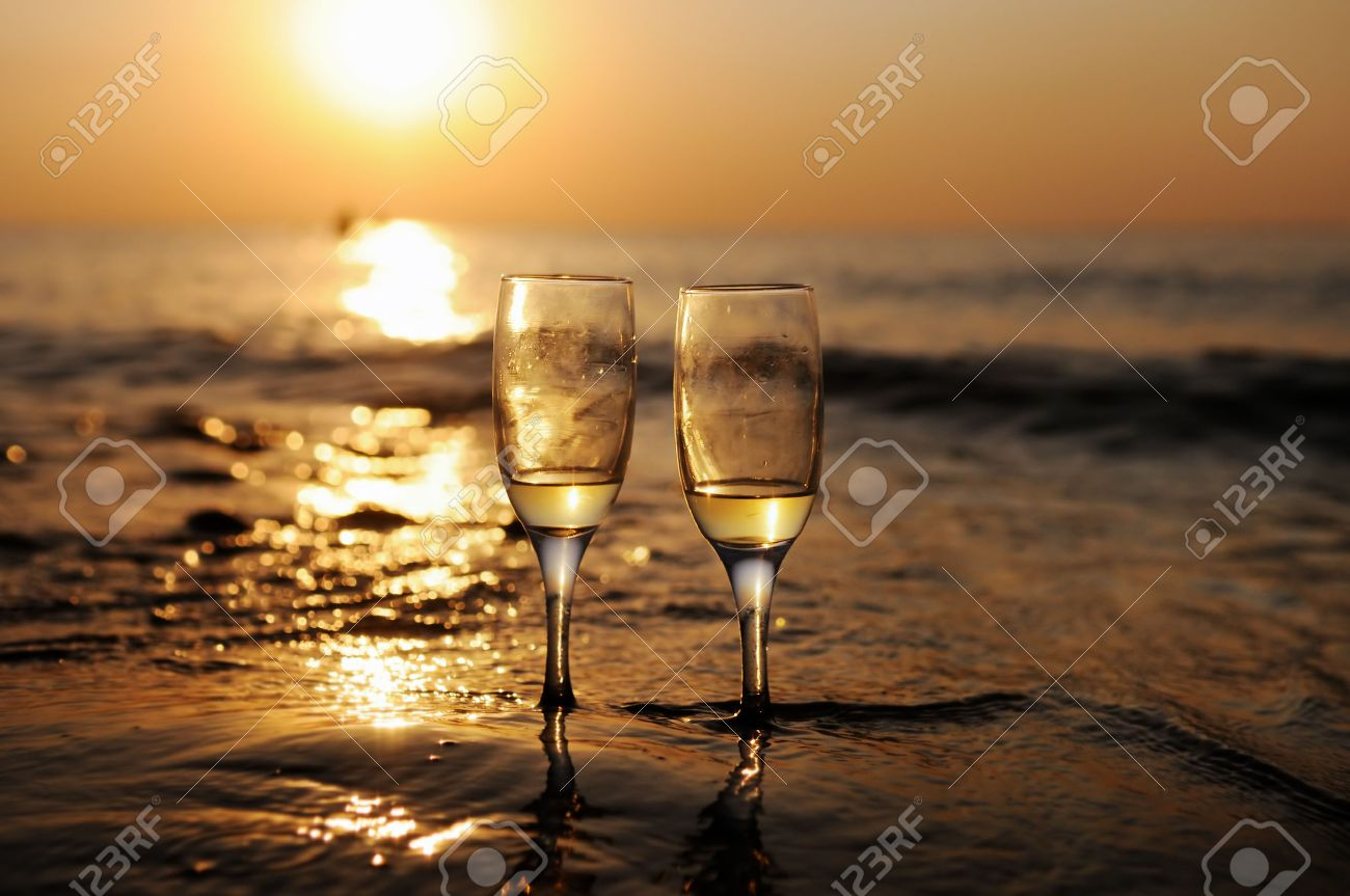 Romantic beach evening on the sunset with two glasses of white wine - 30922447