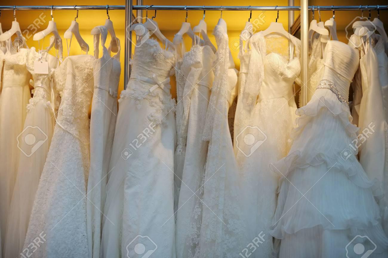 A few beautiful wedding dresses on a hanger - 32743233