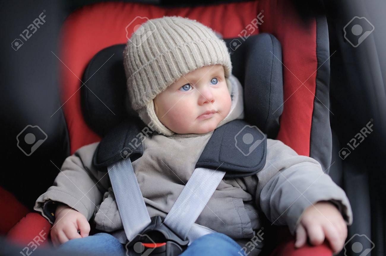 Portrait of toddler boy sitting in car seat - 37230184