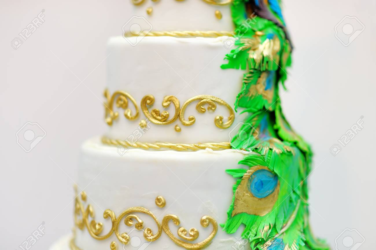 Delicious White Wedding Cake Decorated With Gold And Green Tracery ...