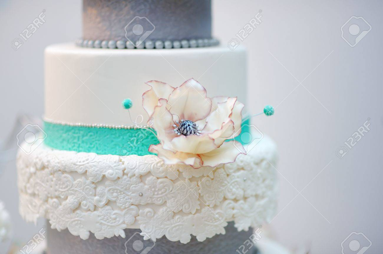 Delicious White And Grey Wedding Cake Decorated With Flowers Stock ...