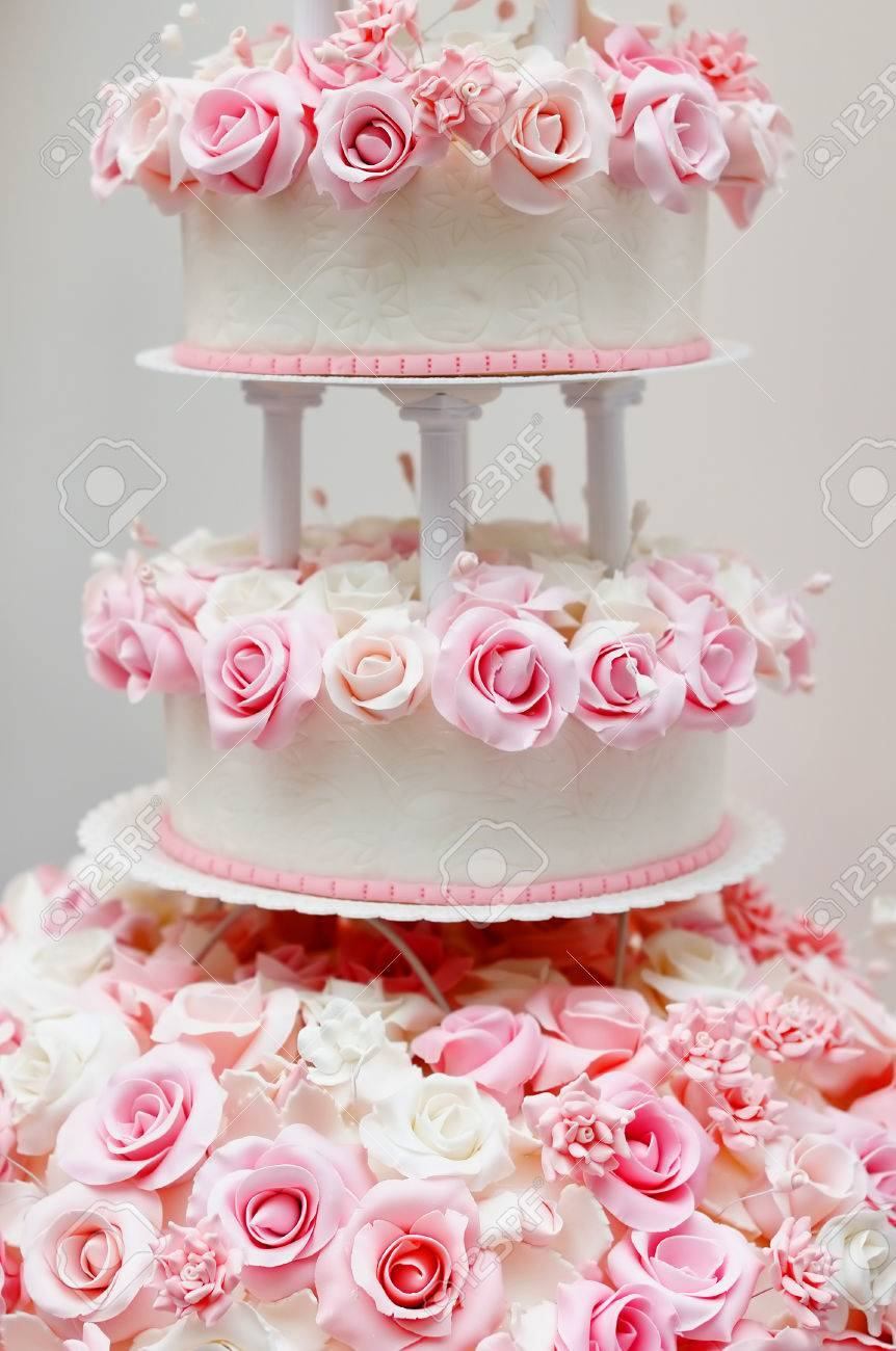 Delicious White Wedding Cake Decorated With Pink Cream Roses Stock ...