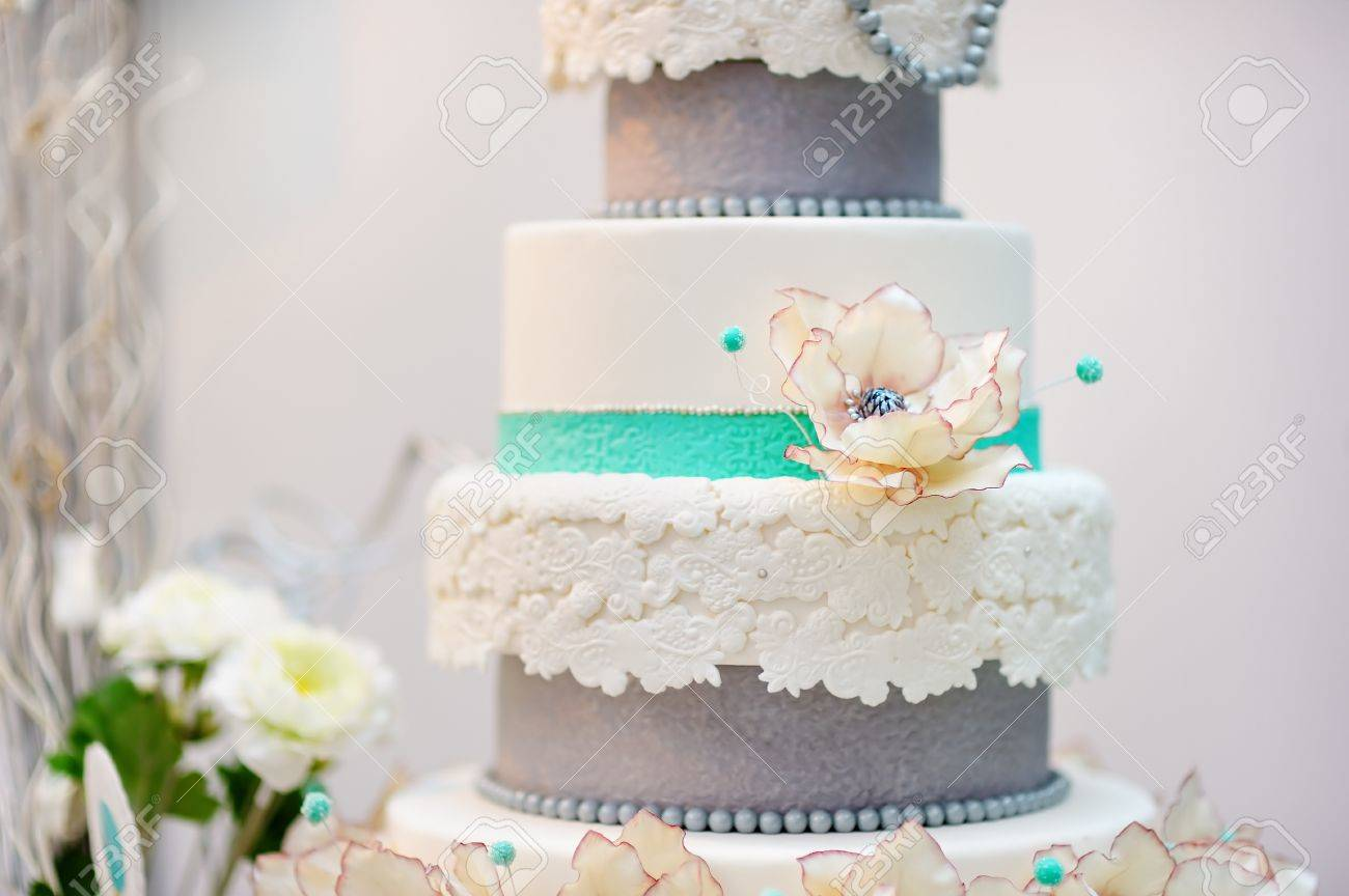 Delicious White And Grey Wedding Or Birthday Cake Decorated With ...