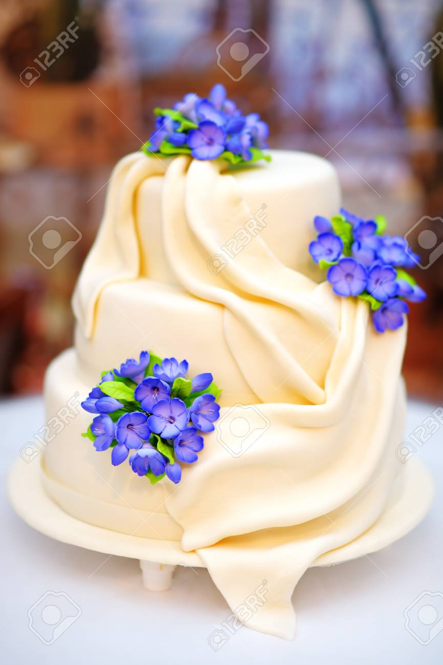 Delicious White Wedding Or Birthday Cake Decorated With Flowers Stock Photo