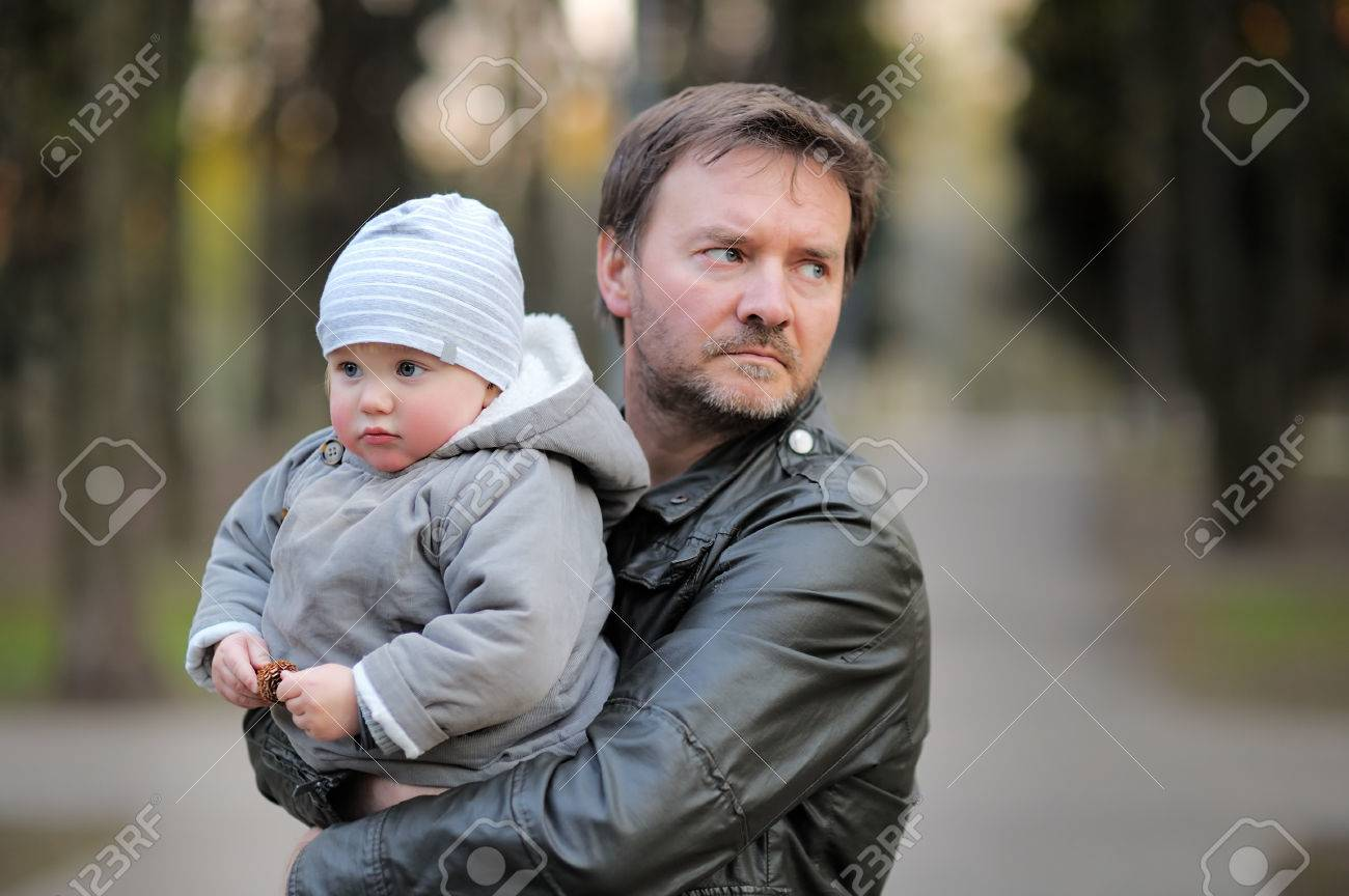 Middle age father with his toddler son walking outdoors / kidnapping concept - 40486657