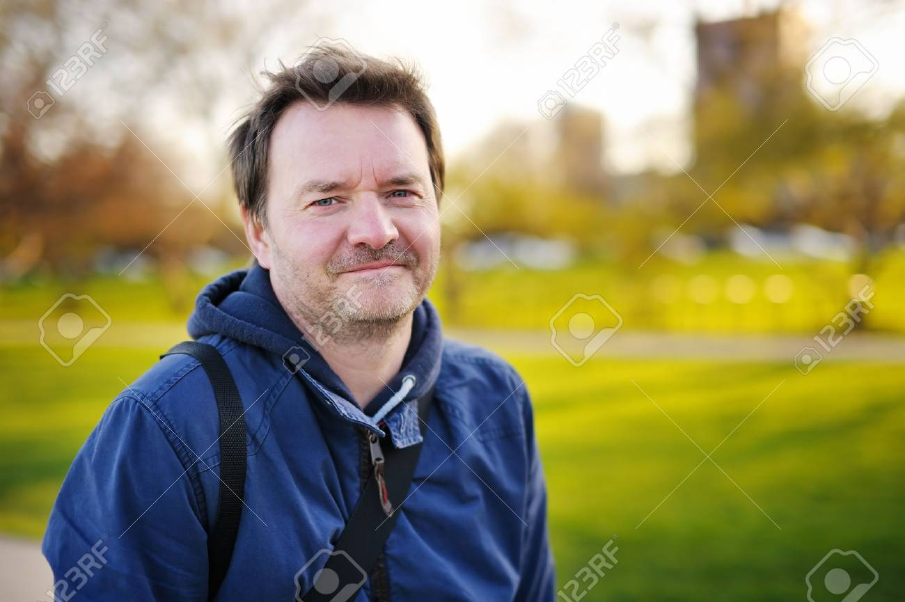 Outdoors portrait of middle age man at the spring, summer or autumn day - 42772497