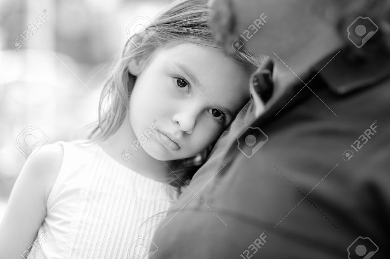 Black and white photo of sad little girl with her father stock photo 43192349