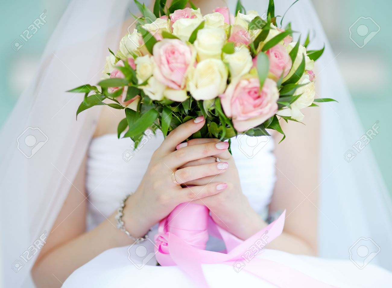 Bride holding wedding flowers roses bouquet, focus in hand and wedding ring - 45137459