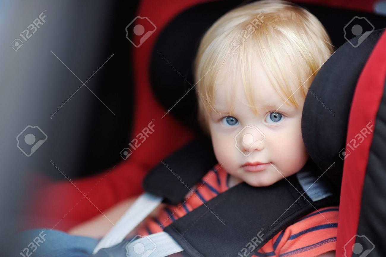Portrait of toddler boy sitting in car seat - 52905237