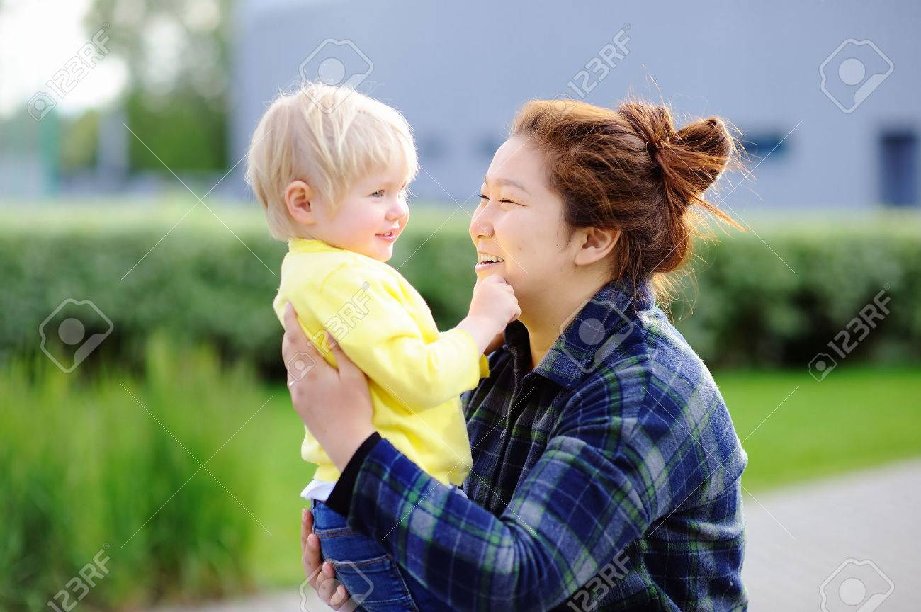 Young asian woman with cute caucasian toddler boy. Babysitting concept - 66155276