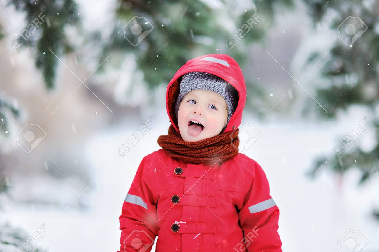 e4fd2ec11 Portrait Of Funny Little Boy In Red Winter Clothes Having Fun ...
