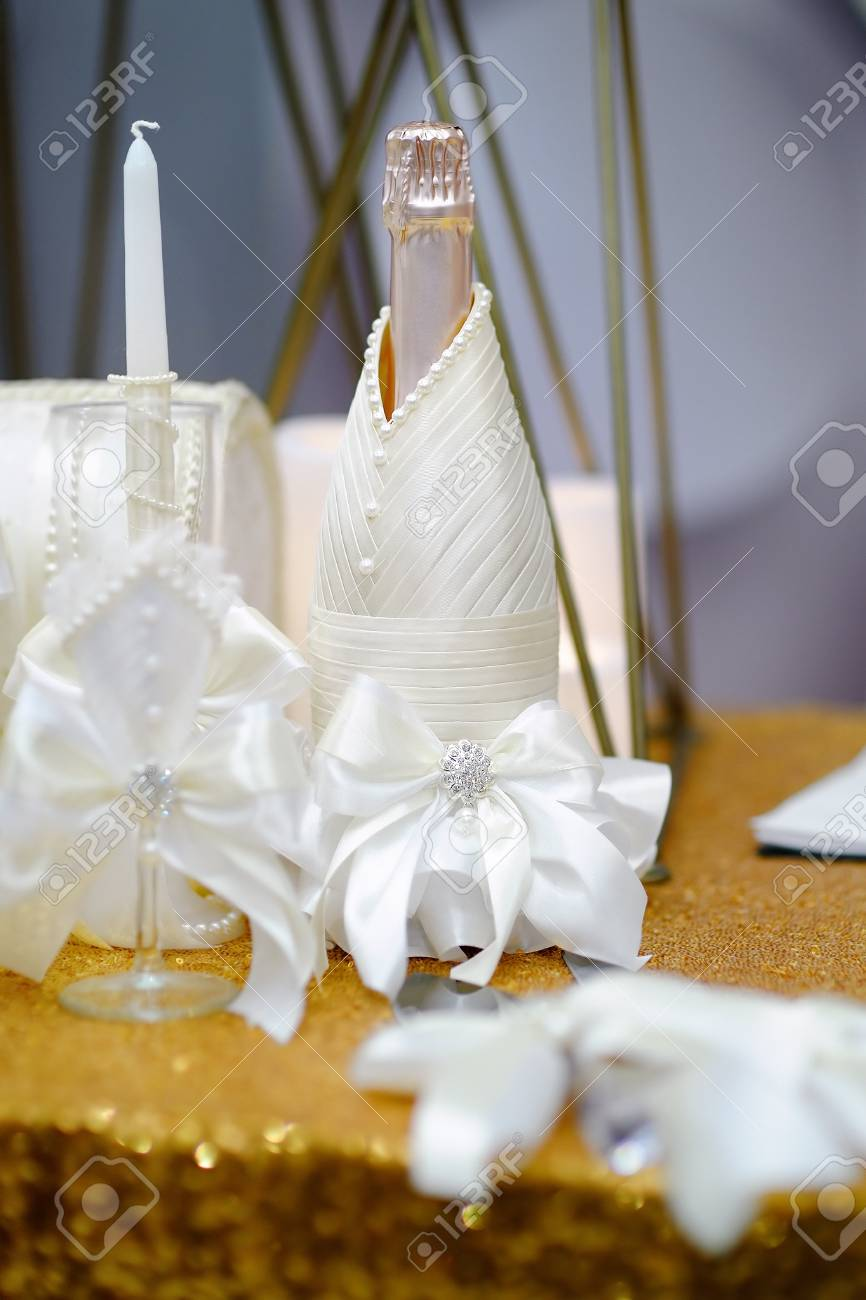 Bottle of champagne and other party accessories on a table for bottle of champagne and other party accessories on a table for wedding reception stock photo junglespirit Image collections