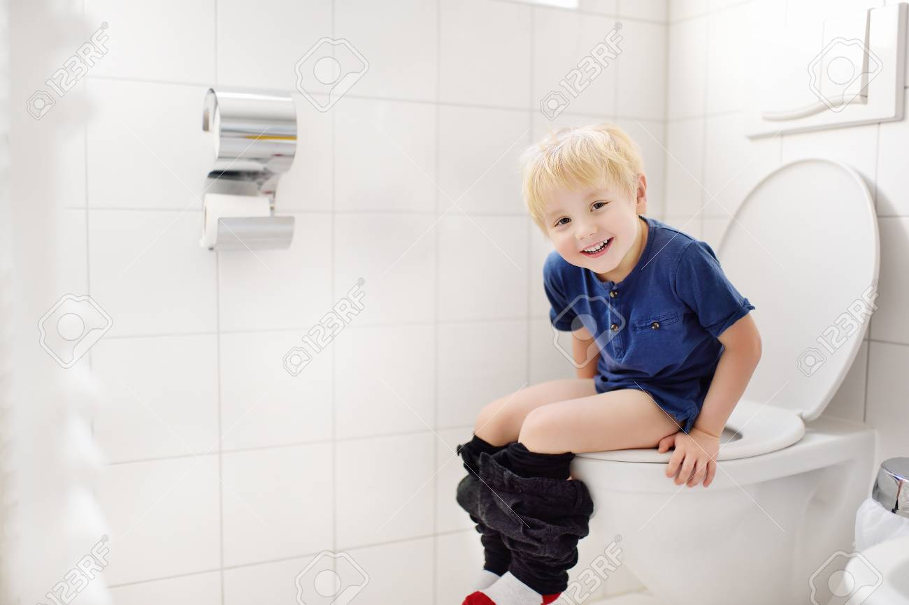 Cute Little Boy In Restroom Toddler Child Trainig Use Toilet Stock Photo Picture And Royalty Free Image Image 95232268