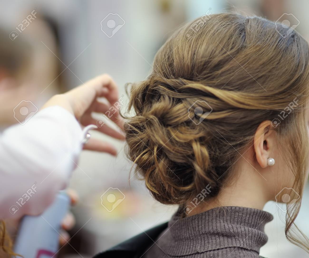 Young woman/bride getting her hair done before wedding or party. Wedding or prom ball hairstyles. - 116636839