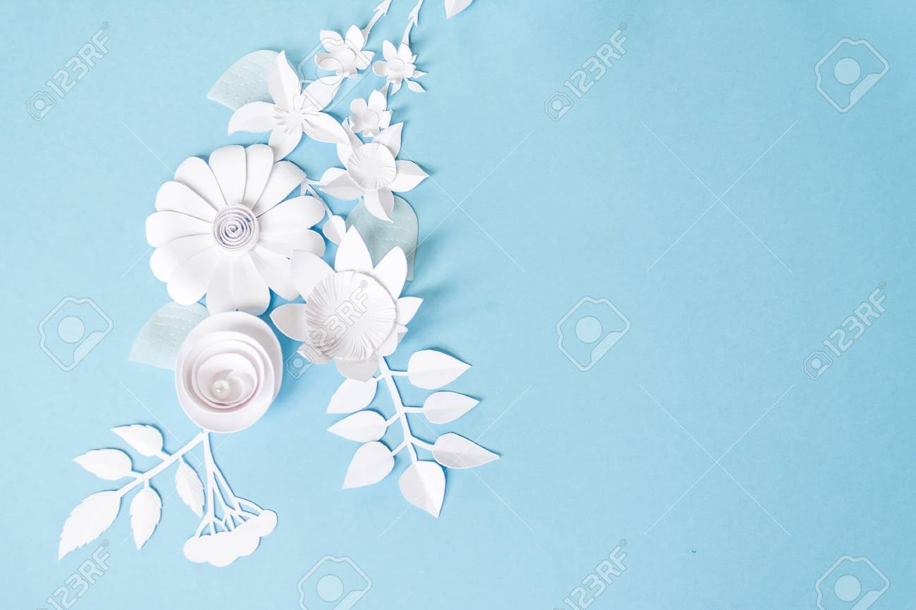 Frame With White Paper Flowers On Blue Background Stock Photo