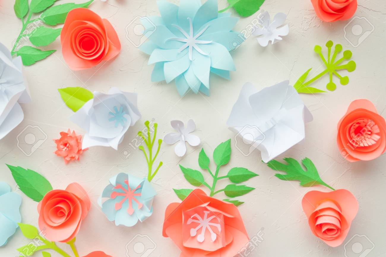 Color paper flowers on the white stucco flat lay nature concept color paper flowers on the white stucco flat lay nature concept cut from mightylinksfo