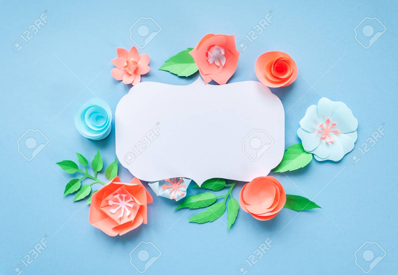 Vintage frame with color paper flowers on the blue background stock photo vintage frame with color paper flowers on the blue background flat lay nature concept mightylinksfo
