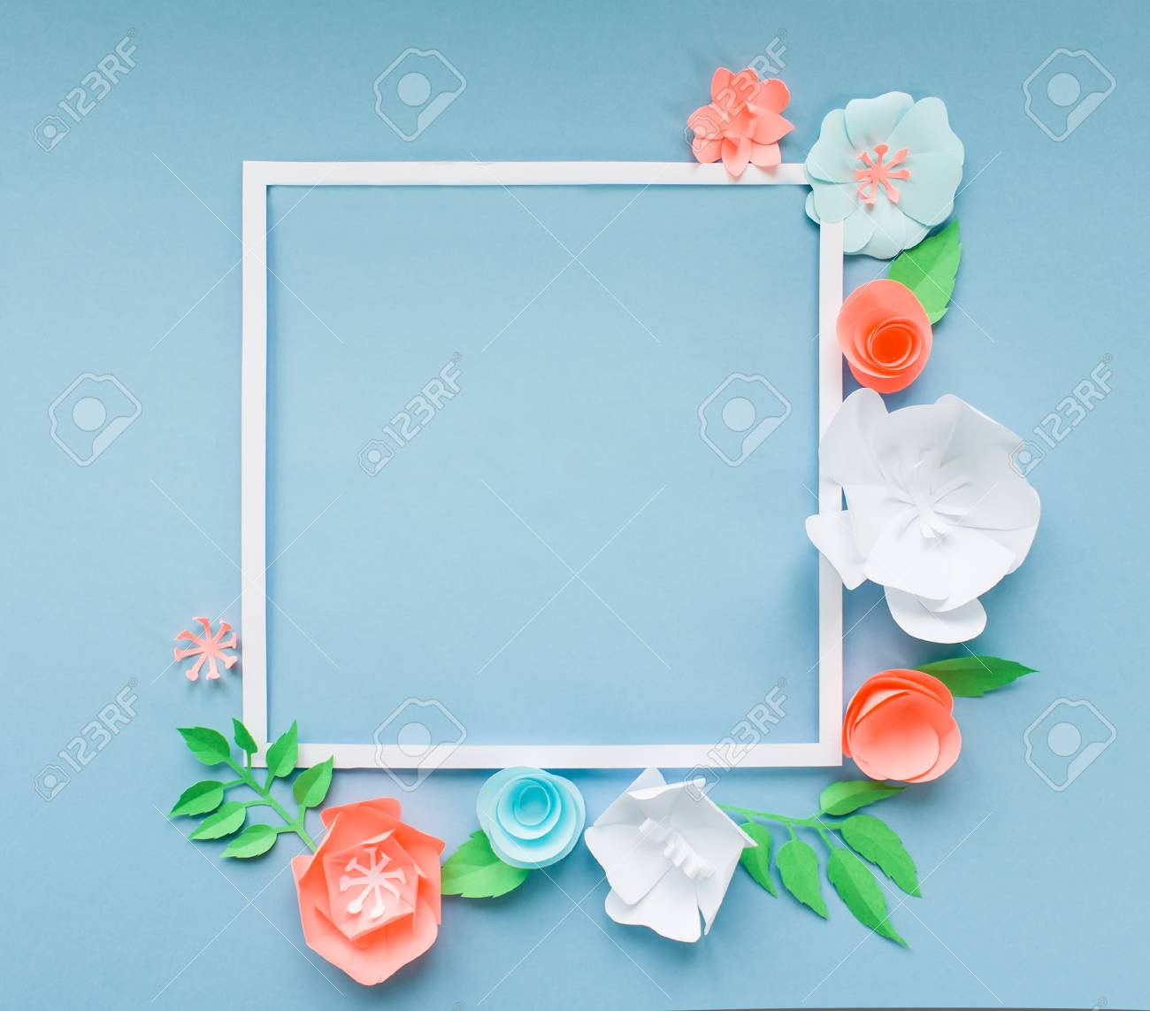 Square Frame With Color Paper Flowers On The Blue Background
