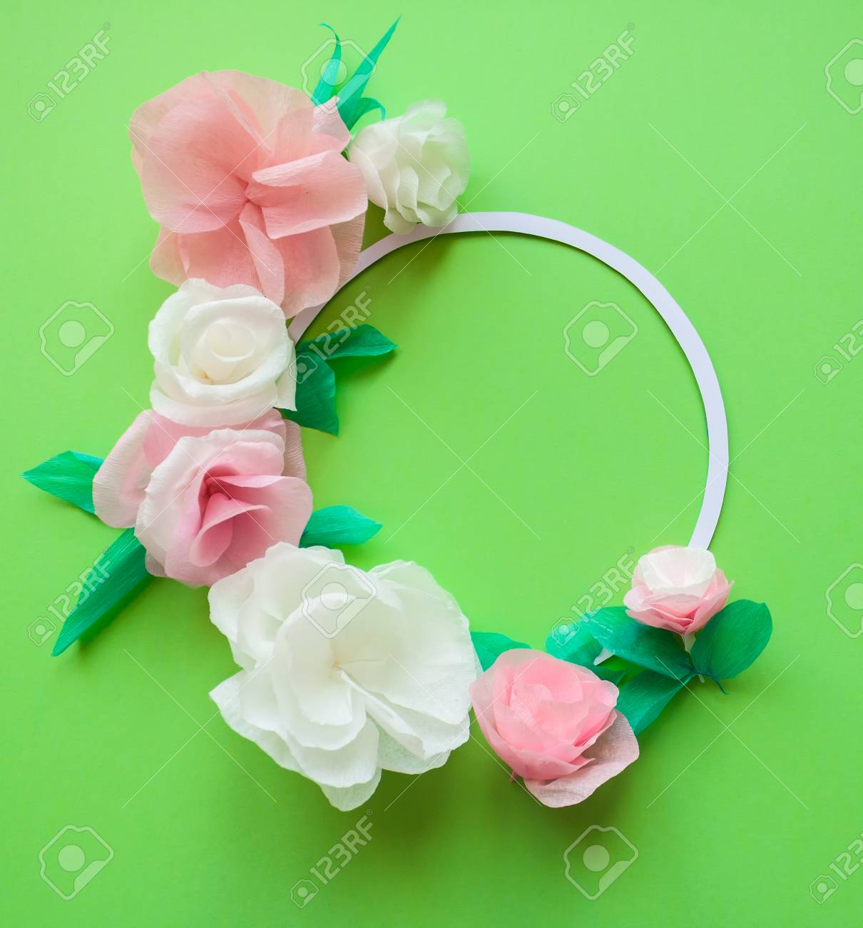 Round Frame With Color Paper Flowers On The Green Background